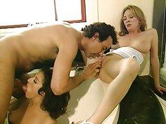 Pleasing two horny women in bathtub