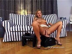 Blond cock tease Sandra De Marco masturbates with her sybian