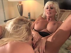 Puma Swede, busty blonde, with her partner Riley Evans in wet masturbation act