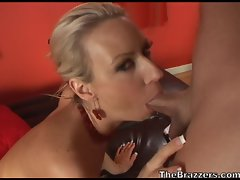 Big titted milf Carolyn Reese sucks and blows a big cock on the couch