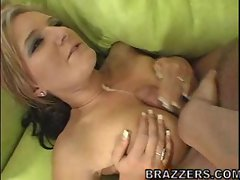 Daryn Darby gets her large tits rubbed by a big dick until it cums