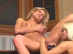 Jana Cova rams a dildo into another lesbian's twat