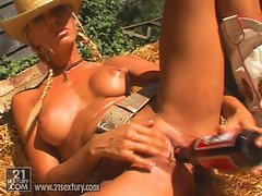 Vega Vixen shows a beer bottle in her dirty pussy