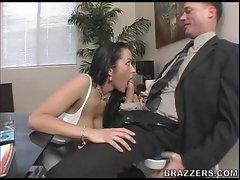 Big boobed Carmella Bing sucks a massive hard dick in her mouth