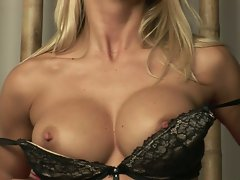 Big titted babe Gitta Szoke works her big tits in an extreme indoor solo