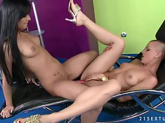 CJ and Angel Pink share toys in some hot girl on girl action