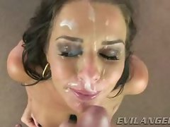 Veronica Avluv gets her face sprayed with warm jizz