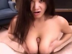 Hot Asian chick with huge tits gives a tittie fuck!