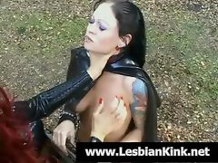 Dark-haired slave girl gets tied to some heavy equipment and receives some punishment from her mistress