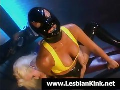 Masked girl with black boots gets some lesbian lovin' from a blonde chick
