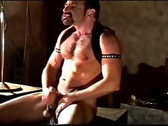 Self CBT session by a hairy muscular man. He's getting off on his self inflicted ball squeezing