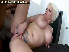Short-haired tattooed young hottie slut with big boobs gets it on with a black brute