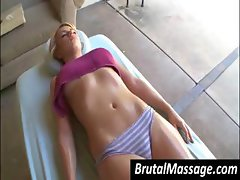 Hot blonde is getting a nice oiled up massage by her masseuse