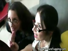 Two mature office ladies love to tug