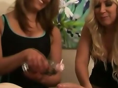 Two bad British girls massage a CFNM guys cock