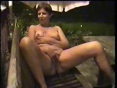 Horny mature wife masturbates in court yard