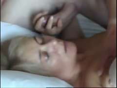 Mature pounded in the bed and cummed on