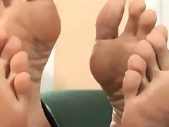 Two chicks showing soles