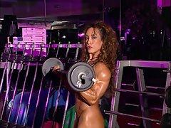 bodybuilder mature in training center with high heels