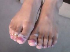 Nataly Rosa makes a cock spit and her sexy feet are the targets