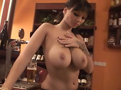 Hot Dominno stops fixing drinks to let everybody see her big hooters