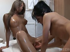 Gorgeous and tall model Nessa Devil oils herself up for a hot lesbian massage