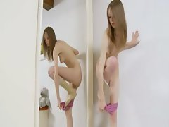 Striptease and masturbate for a mirror