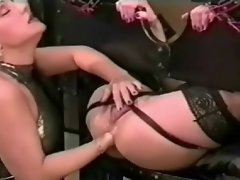 A doll gets a fist banging in each hole