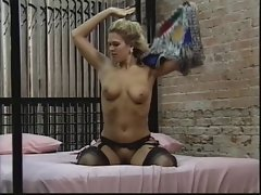 Hot young blonde bends over and shows off her tight pussy for the camera