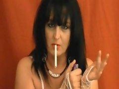Mature brunette smoking and playing