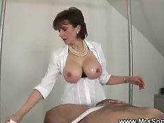 Slave cums on dominas big tits