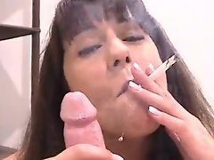 Brunette giving a smoking blowjob