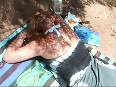 Wanking and cumming on a beach girl