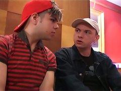 Cute young gay hunks playing huge stiff boners in club
