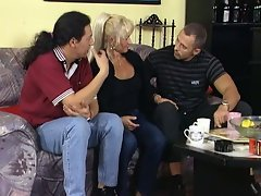 Sexy big tits blonde milf getting shared by two huge cock fuckers