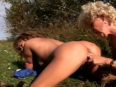Jogging grannies have pussy licking action in the woods