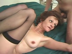 Granny babe takes two hard cocks inside her