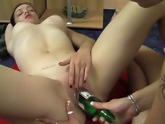 Blonde starts alone and finishes with a brunette and a bottle