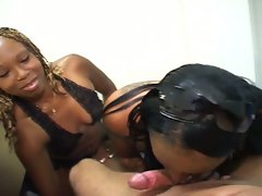 Two nasty ebony babes share a white cock