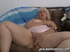 Horny mature woman fingering her pussy