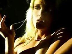 Naked blonde babe smoking and touching her body