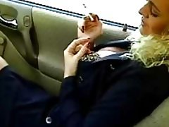 Business babe smoking in the car