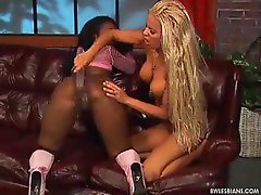 Two sexy chicks sharing a thick dildo