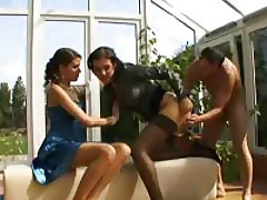 He's having fun with the two fully clothed sluts