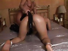 Using a fat dildo in the girl's asshole