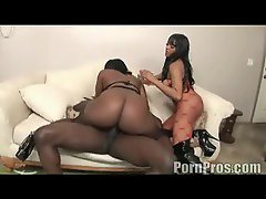 Chick with a huge black ass sits on a black cock