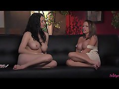 Two busty babes doing a naked interview