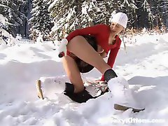 Cutie in the snow using a big dildo