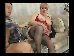 Granny in stockings sitting on a dick
