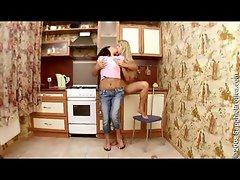 Lesbians fondling in kitchen